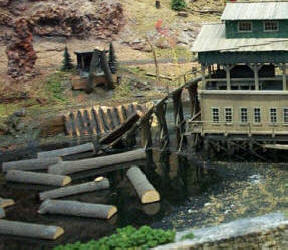 Mill logs on pond at a mirror image, scratch built copy of the Master Creations Coon Gap Sawmill